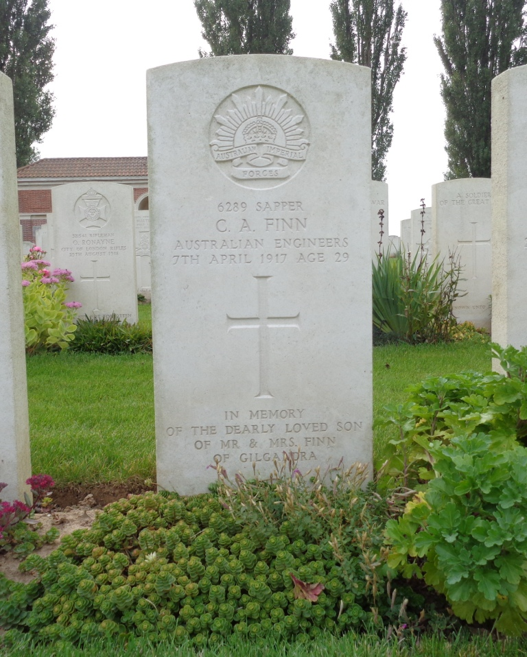 Charles Alfred Finn's headstone at H.A.C. Cemetery, France (Photograph: S.  & H