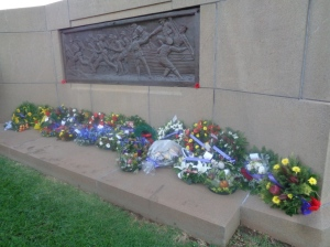 Wreaths at Dubbo War Memorial in the same area where a flag from the Coo-ee March was displayed during the 1925 unveiling of the cenotaph (Photograph: H. Thompson, 25/4/2015)