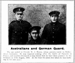 W. J. Munro (seated) with another prisoner of war and a German guard, 1918 (Cumberland Argus and Fruitgrowers Advocate, 8/6/1918)